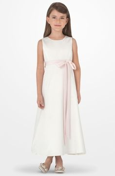 Free shipping and returns on Us Angels Sleeveless Satin Dress (Toddler Girls, Little Girls & Big Girls) at Nordstrom.com. A slender sash cinches the waist of a sleeveless satin dress fashioned with a jewel neckline and a long A-line silhouette for a look that's simple and sweet.
