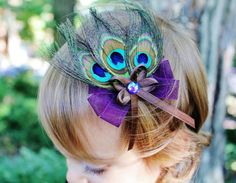 We are never too young for a thing of beauty! Peacock feather hair bow by Etsy seller SweetestBugBows.
