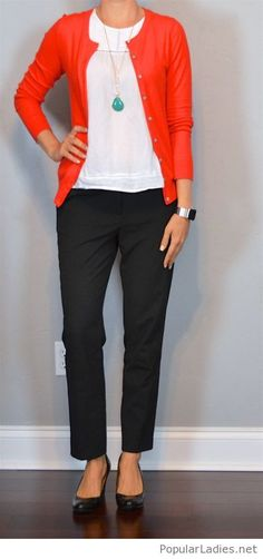 Black pants, white top and red cardi