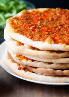 Lahmacun Turkish Pizza recipe (use lamb or beef, and middle eastern spices, then you put on your fav salad ingredients after they're baked.)they are pictured stacked - istanbul turkey food - *Cumin Turkish Pizza Recipes, Lebanese Recipes, Greek Recipes, Arabic Recipes, Arabian Food, Good Food, Yummy Food, Eastern Cuisine, Middle Eastern Recipes