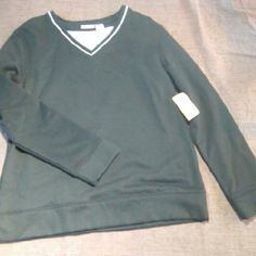 Kim Rogers Sweatshirt This Kim Rogers sweatshirt is brand new still with tags and states that it is a size medium. I would say that it is in between a medium and a large. it is black and white in color and made from 60% cotton and 40% polyester. It measures from the shoulder at 26 inches long. Kim Rogers Sweaters