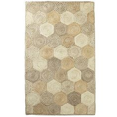 Think we've already hexagon too far? Just you wait. This rug goes geometric with six-sided patches of 100% natural jute, hand-woven for exquisite texture and comfort. And its soothing tan shades let you put a stylish touch on any room.