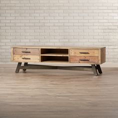 You'll love the Alsatia TV Stand at AllModern - With Great Deals on modern Living  products and Free Shipping on most stuff, even the big stuff.