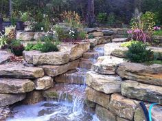 39 Inspiring Waterfall Design To Beautify Your Garden. The two most frequent ways of installing a waterfall are to use a pre-formed waterfall or maybe to create a waterfall of pure stone on a flexible. Sloped Backyard, Backyard Pool Landscaping, Backyard Water Feature, Ponds Backyard, Landscaping With Rocks, Backyard Ideas, Outdoor Ideas, Outdoor Spaces, Garden Ideas