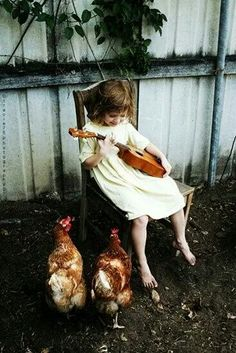 Sweet little country girl just playing a little music for the chickens