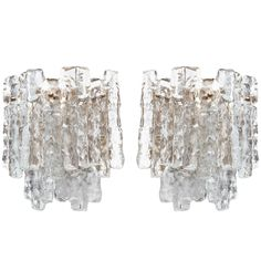 Pair of Two-Tier Ice Glass and Brass Sconces by JT Kalmar | From a unique collection of antique and modern wall lights and sconces at https://www.1stdibs.com/furniture/lighting/sconces-wall-lights/