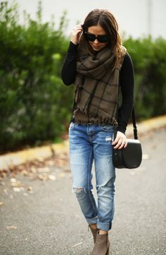 Black long sleeve tee/sweater, distressed boyfriend jeans,  taupe ankle boots, black saddle bag, black and taupe scarf