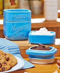 """So cute you'll want to display it on your countertop, this Mason Jar Measuring Set is full of country charm and functionality. The four cups stack on top of each other to form a Mason jar shape. The smallest cup becomes a """"lid"""" when you turn it over. 3-1"""