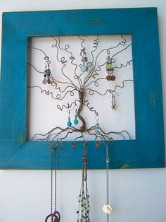 Clean up your jewelry box clutter and and add something unique and whimisical to your wall. Frame measures 14 x 14 inches along the outside