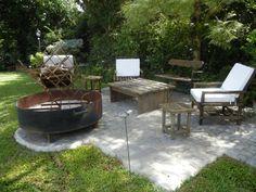 CASA EN LA HORQUETA: Jardines de estilo Moderno por Fainzilber Arqts.