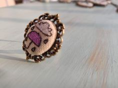Umbrella with cloud and rain flowerpots cross stitch ring on bronze frame, charm rin, cross stich jewelry, vintage style, gift for her Purple Umbrella, Bronze Ring, Flower Pots, Cloud, Gifts For Her, Custom Design, Gemstone Rings, Cross Stitch, Pendants