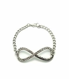 """Iced Out One Direction Infinity Directioner Bracelet 4mm Link Chain XB282 (Silver) NYfashion101, Inc. $12.99. One Direction Fan Bracelet. 4mm 7"""" long link bracelet. Size of Charm: 2"""" & 0.75"""". New Iced Out Bracelet. Infinity Bracelet. Save 43% Off!"""