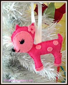 Felt Christmas Ornament  I will definitely have to make a cute little felt deer or reindeer in aqua or turquoise for my tree.   Wonderful inspiration!