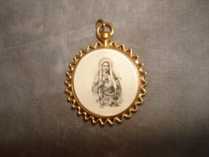 Vintage SACRED HEART of MARY Catholic Medal Unique Gold Frame w/Convex Glass by PastPossessionsOnly on Etsy