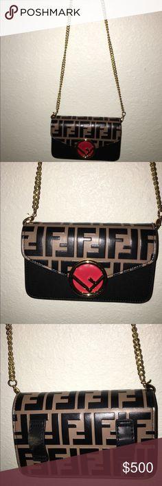 Fendi Clutch Mini bag with geometric flap decorated with the new Fendi  logo. Press- 23fed1bcae356