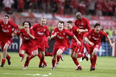 Ecstatic Liverpool players run towards goalkeeper Jerzy Dudek after AC Milans Andriy Shevchenko missed his penalty in the 2005 Champions League final shootout.