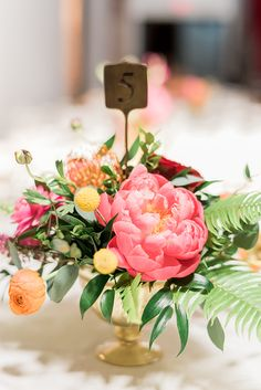 coral charm peony centerpieces - photo by A.J. Dunlap Photography http://ruffledblog.com/brightly-colorful-sequined-wedding