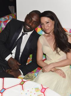 Pin for Later: Relive the Best Moments From the 2014 Emmys  Idris Elba and Lucy Liu relaxed at the HBO party.