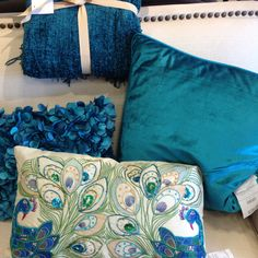 Bedroom pillows...love this peacock blue color!