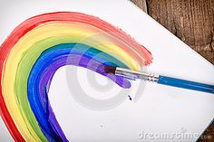 Painting of rainbow on notebook by Sjhuls, via Dreamstime