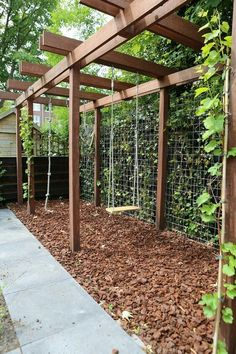 Elongated pergola construction that serves as a play element and as a view blocking ., Elongated pergola construction that serves as a play element and as a viewing block . Although ancient inside notion, this pergola has been suffering.