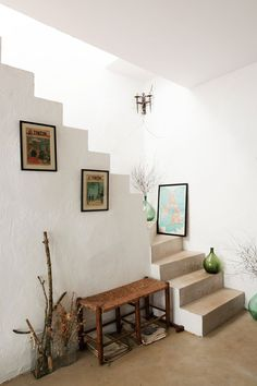 simple stairwell with natural elements and framed art prints. / sfgirlbybay
