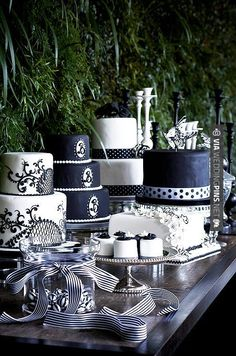 Wow! - Cluster a group of black and white cakes in different sizes and shapes for a dessert display full of tempting options. | CHECK OUT MORE GREAT BLACK AND WHITE WEDDING IDEAS AT WEDDINGPINS.NET | #weddings #wedding #blackandwhitewedding #blackandwhiteweddingphotos #events #forweddings #iloveweddings #blackandwhite #romance #vintage #blackwedding #planners #whitewedding #ceremonyphotos #weddingphotos #weddingpictures