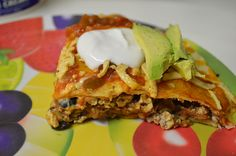 """themessyveganteen   Easy Vegan Taco Pie Taco is pie is a delicious,layered dish with vegan cheese,mock """"meaty crumbles"""",tofu and black bean filling,refried beans and lots of enchilada sauce! It's perfect served with a avocado,salsa and a dollop of vegan sour cream."""