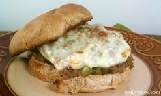 Philly Cheesesteak Sloppy Joes:  juicy beef with sautéed peppers and onions, smothered in Provolone cheese and sandwiched in a toasty bun! Only 334 calories or 7 Weight Watchers SmartPoints per sandwich. www.emilybites.com