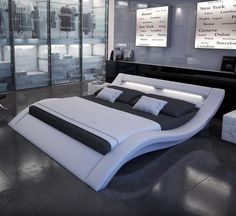 """The Zeus bed is constructed from black or white leatherette with a unique contemporary curved design.  The headboard comes with LED lighting to create a unique look.  Bed comes with slat support system.  Queen: 106""""x 75""""x 31""""  King: 112""""x 91""""x 31"""""""