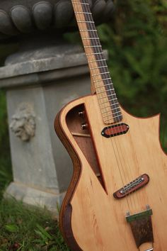 Raulo Guitars - electro acoustic, such a clever place to put the electrics.