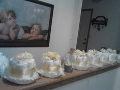 Several Miniature Diaper cakes and goodies for the baby shower.