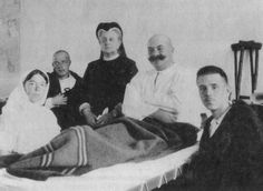 Grand Duchess Olga Alexandra and her Aunt Queen Olga of Greece with soldiers in a hospital during WWI