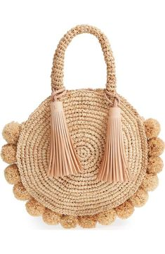 Bouncy pompoms highlight the perfectly circular silhouette of a woven-raffia tote topped with rounded handles and a pair of swingy tassels. Style Name:Loeffle… Pom Pom Purse, Tassel Purse, Crochet Handbags, Crochet Purses, Straw Handbags, Tote Handbags, Tote Bags, Fashion Handbags, Fashion Bags