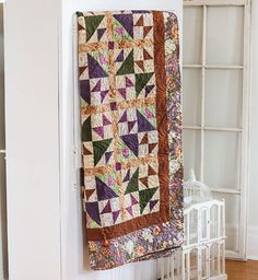 This quilt pattern from Love of Quilting Sept/Oct '13 is a throw size quilt pattern featuring triangle squares and contemporary quilt fabrics.