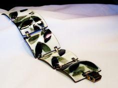 Wonderful whimsical bracelet is made by Kay Denning
