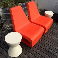 2 orange molded plastic outdoor chairs 2 molded plastic stools, table, icebuckets Howell Furniture, Plastic Molds, Floor Chair, Stools, Outdoor Chairs, Gadgets, Flooring, Orange, Table