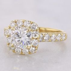The Bella Yellow Gold Cushion Halo Engagement Ring with 1.50ct Forever One Moissanite