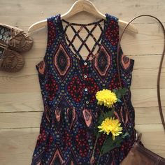 | NWT Forever21 Dress Brand new with tags colorful geometric sleeveless dress.  Drapes beautifully.  100% rayon. In new condition. Forever 21 Dresses
