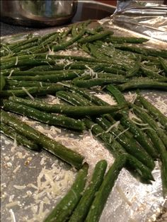 Skinny Taste Roasted Parmesan Green Beans --- i didn't use the parmesan-- just used the olive oil salt and pepper--- the frozen green beans from trader joes-- YUM-