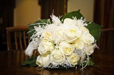 Lauren's Bouquet. White roses with feathers and crystals.  Lauren's Wizard of Oz themed wedding. Wedding Dress and bridesmaids' corsets by Castle Corsetry