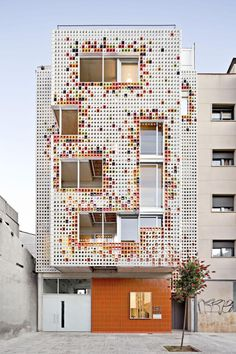 Multifamily Housing Designed with a Shiny Colorful Ceramic Facade in Architecture Exterior Cladding, Building Facade, Facade Design, Affordable Housing, Facade Architecture, Facade House, Home, Facades, Multi Storey Building