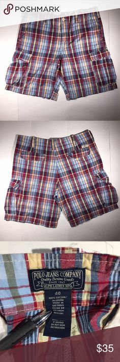 MENS RALPH LAUREN POLO RED PLAID CARGO SHORTS MENS RALPH LAUREN POLO RED PLAID CARGO SHORTS SZ 40  *Please see below for exact measurements*  - Excellent Used Condition!  Measurements;  Waist - 20'' across , 40'' all the way around  inseam - 11''  outseam - 23.5''  front rise - 13''  back rise - 15''  leg opening - 12'' Polo by Ralph Lauren Shorts Cargo