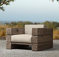 RH's Aspen Lounge Chair:We've interpreted the earthiness and strength of a Scandinavian artisan design by Søren Rose in the Aspen collection. Hewn from massive timbers of French oak, every piece celebrates nature in its rustic simplicity.