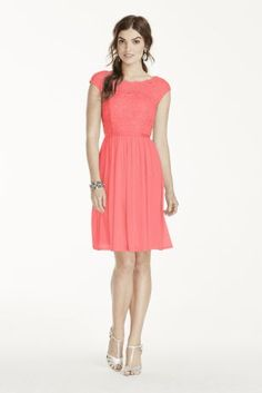 This beautiful lace dress is perfect for a wedding party or any special event!  Features cap sleeve