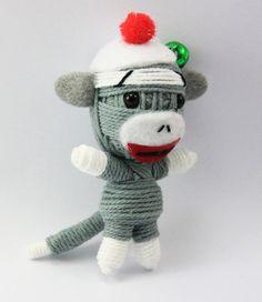 definitely want this one! Sock Monkey String doll Voodoo doll keychain by narakdoll on Etsy, $6.99