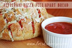 The Super Bowl is right around the corner, and this pizza bread is sure to be a hit with everyone at your party, kids and grown-ups alike. My family absolutely devoured it! It's so easy...
