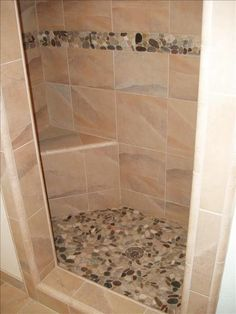 river stone shower floor and accent