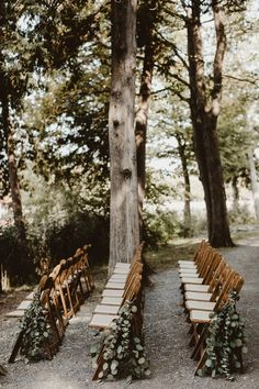 Draped greenery is a simple wedding aisle maker that also makes a statement | Image by Hazel Eyes