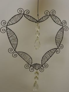 A hart shaped window ornament from wire.